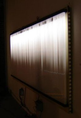 horizontal array of 84 vertical fluorescent tubes, top halves glowing
