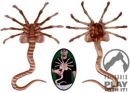 [Facehugger spider-thing from the movie Alien, plush toy grabbed onto guy with black t-shirt]