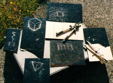 [JPG: PHOTO OF VARIOUS HAND-DRAWN HOLOGRAMS IN THE SUN]