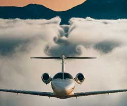 A Cessna Citation leaves a deep trough in the clouds beneath it, proof that it stays aloft by pushing air down.